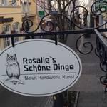 Rosalie's Ladenschild am Ausleger